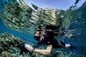 UW photographer in shallow waters..... by Iyad Suleyman