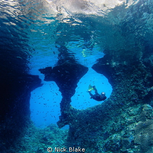 Boo Windows and Freediver, Raja Ampat. by Nick Blake