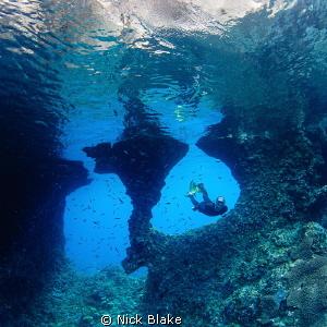 Boo Windows and Freediver, Raja Ampat. by Nick Blake