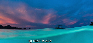 This is actually a split shot, but more topside than unde... by Nick Blake