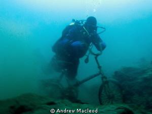 A bike in lake Baikal by Andrew Macleod
