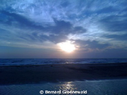 This is a shot of Sodwana with the sun rising over the se... by Bernard Groenewald