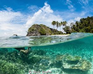 Enjoying a surface interval between dives. Misool, Raja ... by Nick Blake
