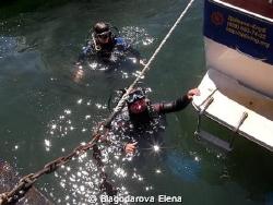 Each diver has Neptune bunch of star flowers if he is smi... by Blagodarova Elena
