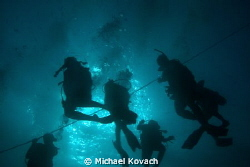Divers on their way to the wreck of the Sea Emperor out o... by Michael Kovach