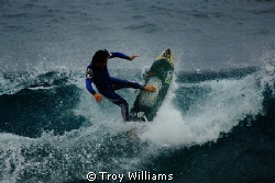 Surfer @ Sunabe Seawall, Okinawa, Japan by Troy Williams