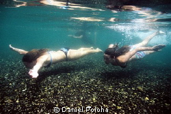 Girls swimming in the clear waters of Tarawera River