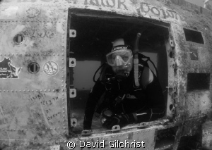 Diver poses inside Blackhawk Helicopter by David Gilchrist