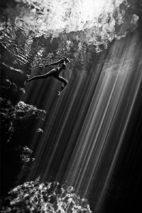 Jump into the sunlight  ( Cenotes/ Mexico ) by Lucie Drlikova