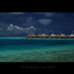 Bora Bora, French Polynesia. Stilt huts, 87 degree water,... by Christopher Ward