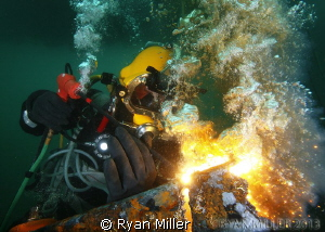 Commercial Diver burning by Ryan Miller
