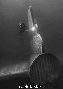 Aircraft tail and diver, Capernwray by Nick Blake