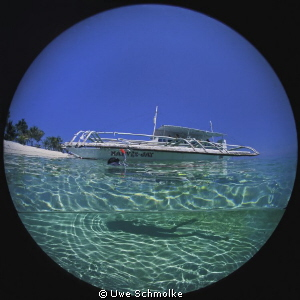 Bangka and shadow. Image is taken with a 8mm circular Fi... by Uwe Schmolke
