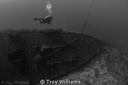 Diver heading for the ascent line on the USS Emmons @ 120ft. by Troy Williams