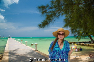 Taking a break from diving.  Daughter at Rum Point, Grand... by Patrick Reardon