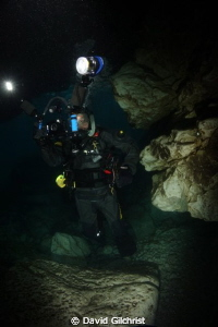 Diver/Photographer at the 'Grotto' site near Tobermory, O... by David Gilchrist