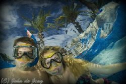 My daughter and her friend in the swimming pool of our ho... by John De Jong