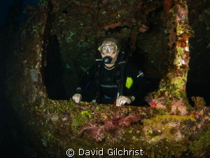 Diver exits Truk Lagoon wreck. by David Gilchrist