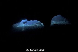 the picturesque cave of gato island by Andrea Acri