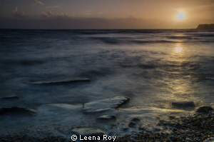 Kimmeridge bay at sunset by Leena Roy