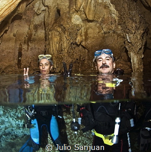 Reflections in a cave in Palau. One strobe underwater and... by Julio Sanjuan