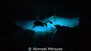 Evelio and Eduardo Exploring Cenote by Abimael Márquez