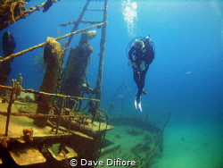 Hovering over Wreck in Nassau by Dave Difiore