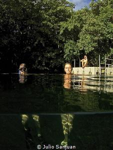 Relaxing time in Palau Jellyfish Lake by Julio Sanjuan