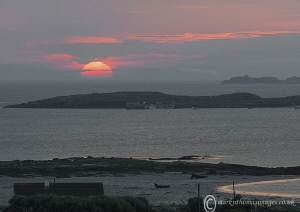 Sunset over Aughrus, Connemara. by Mark Thomas