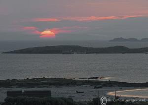 Sunset over Aughrus, Connemara. by Mark Thomas