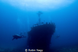 Divers on the wreck of Fishing boat, Beqa Lagoon, Viti Le... by Robin Nagy
