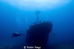 Divers on the wreck of Fishing boat, Beqa Lagoon, Viti Le... by Robin Nagy