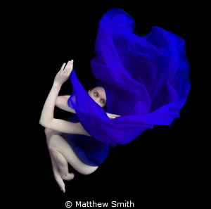 Natural lighting in a pool with a black weighted back cloth. by Matthew Smith