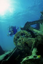Underwater Videographer delighted during a nice dive in a... by Francisco Nakahara