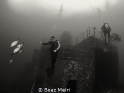 Divers at the Vandenberg shipwreck, Key West, FL. by Boaz Meiri