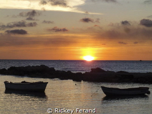 Sunset from patio at the Sea Side Terrace restaurant, Fis... by Rickey Ferand