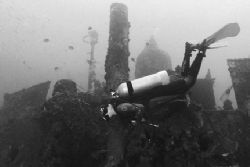 Diver explores the wreck of the Antilla. Nikonos V, 20mm ... by Matthew Shanley