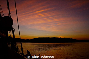 komodo liveaboard at sunset by Alan Johnson