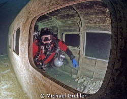 Diver inside airplane wreck in Morrison's Quarry under th... by Michael Grebler