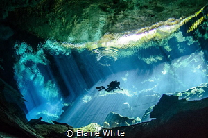 Light show in Kululkan, Cenotes by Elaine White