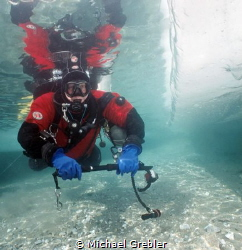 Ice diver at the shallow entry point in Morrisons Quarry.... by Michael Grebler