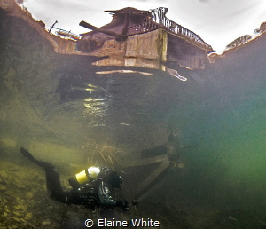 Diver in the shallows beneath the boat house, Eccleston D... by Elaine White