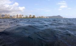 About to submerge...Diamond Head off Waikiki. by Glenn Poulain