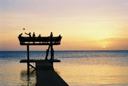 Roatan, Honduras. Locals on the Pier. by Morgan Douglas