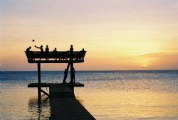 Roatan, Honduras. Locals on the Pier. by Morgan Douglas