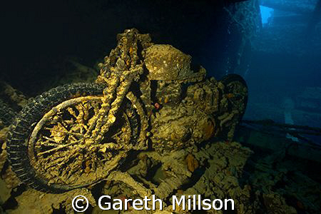 Motorcycle in Hold of the SS Thistlegorm.  Canon 10-22mm wide angle.  Balanced natural light through hold doors with strobes with a 1/50 shutter.