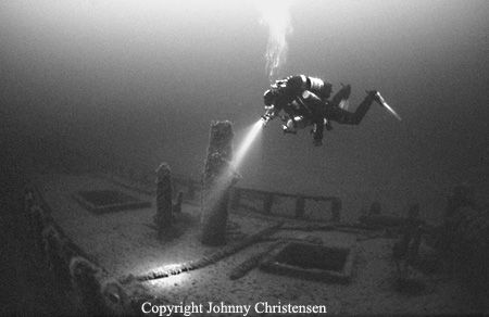 Affaire is a 112 years old wreck, still nicely preserved in the Baltic Sea. The depth was 42 meters, so I used a 1600 ISO B/W film to capture the dim light. There is only a slight touch of strobe light on the diver. Everything else is ambient light.