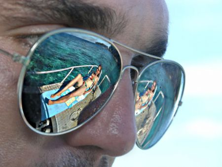 The old shiny sunglasses trick. A dive buddy on the deck of Faded Glory. Madang, Papua New Guinea.