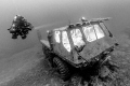 Stalwart Amphibious Vehicle, interior cab lit with external remote controlled strobes. Image converted to black and white