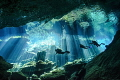 Divers enjoying the spectacular natural lighting display in Kukulkan